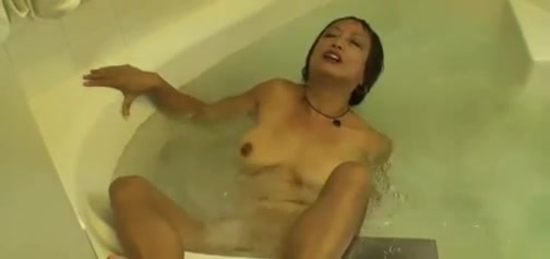 Horny Asian Granny Fucks her Cunt in the Hot Tub