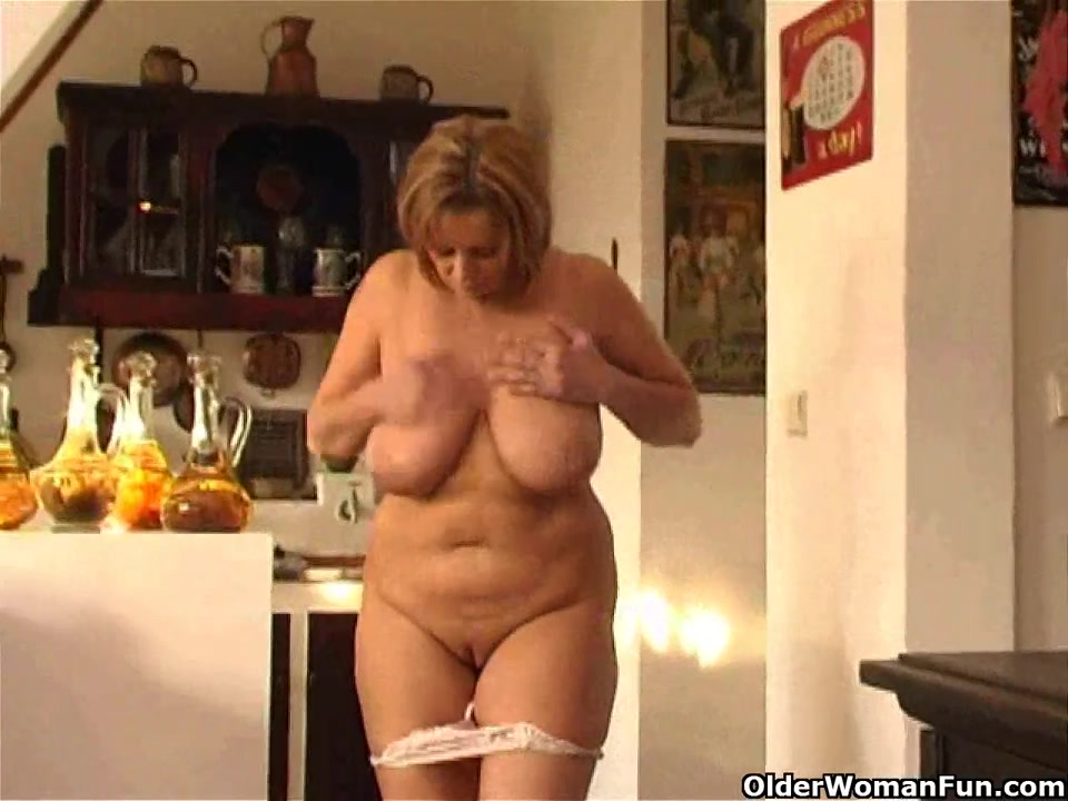 Overweight aged woman with large bra buddies
