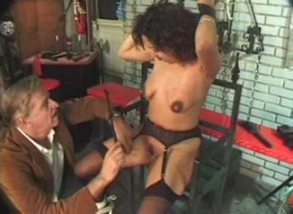 Vintage BDSM scene with a pregnant MILF