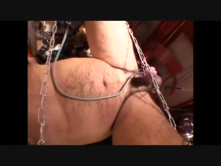 Mistress in a painful bdsm session with male slave