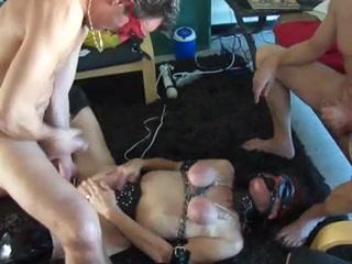 Curvy slut enjoys a kinky BDSM threesome fun