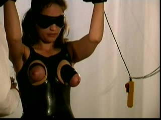 Busty brunette enjoys a latex BDSM fun